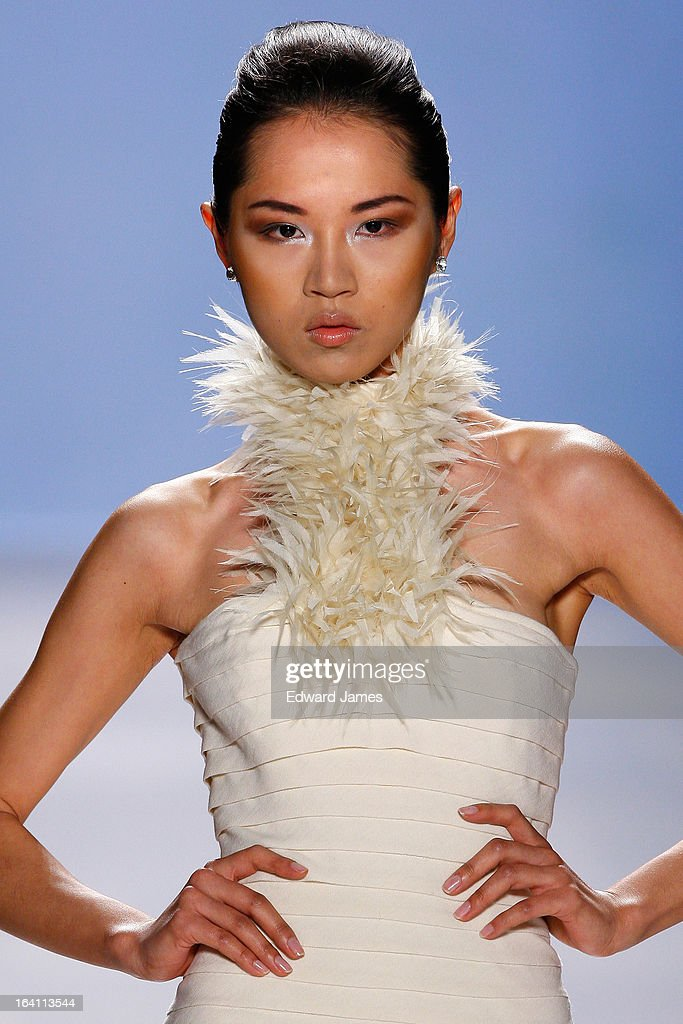 A model walks the runway during Duy at David Pecaut Square on March 19, 2013 in Toronto, Canada.