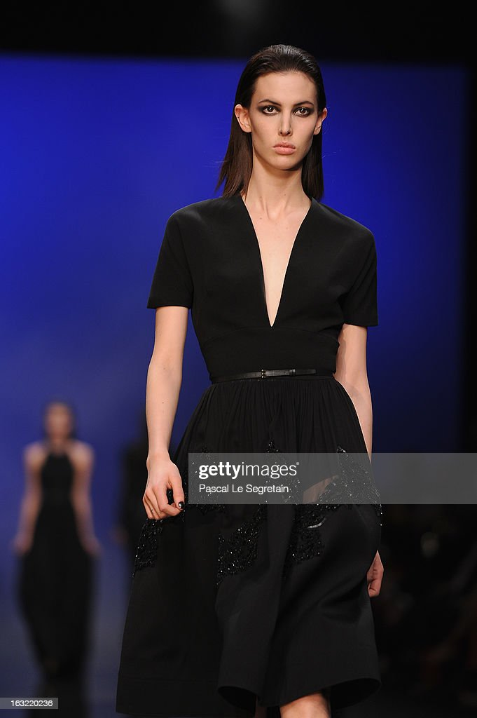 A model walks the runway during Elie Saab Fall/Winter 2013 Ready-to-Wear show as part of Paris Fashion Week on March 6, 2013 in Paris, France.