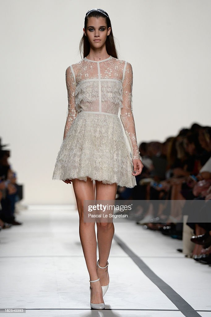 A model walks the runway during Elie Saab show as part of the Paris Fashion Week Womenswear Spring/Summer 2014 at Espace Ephemere Tuileries on September 30, 2013 in Paris, France.