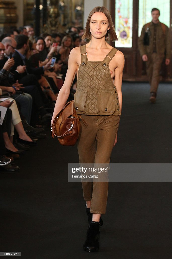 A model walks the runway during Ellus show at Sao Paulo Fashion Week Winter 2014 on October 30, 2013 in Sao Paulo, Brazil.