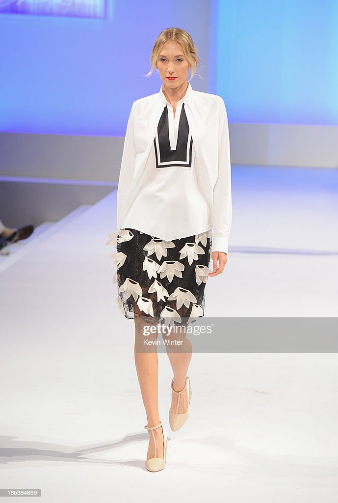 A model walks the runway during Elyse Walker Presents The Pink Party 2013 hosted by Anne Hathaway at Barker Hangar on October 19, 2013 in Santa Monica, California.