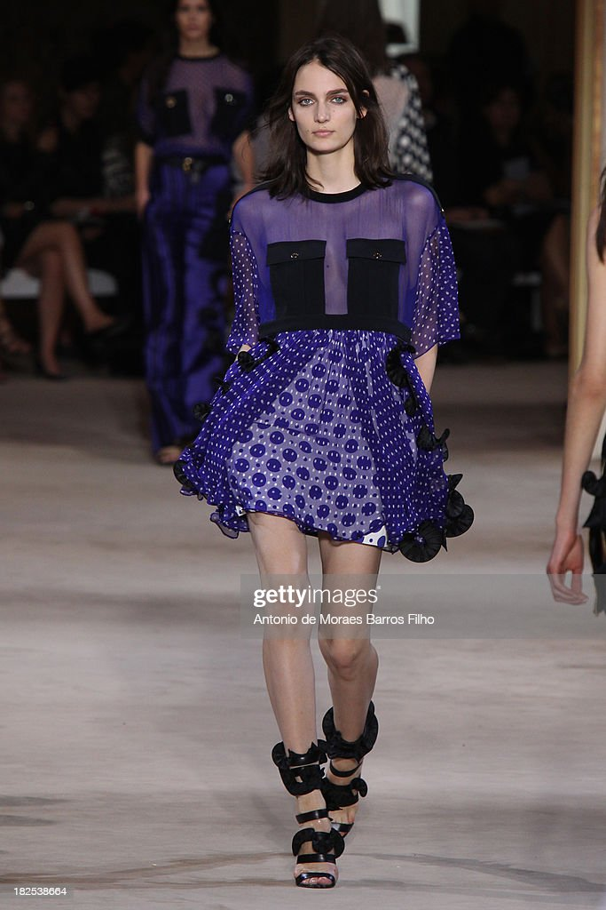 A model walks the runway during Emanuel Ungaro show as part of the Paris Fashion Week Womenswear Spring/Summer 2014 on September 30, 2013 in Paris, France.