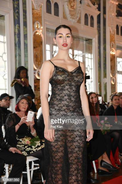 A model walks the runway during 'Fashion Night Couture 2017' Show at Salon des Miroirs on April 26 2017 in Paris France