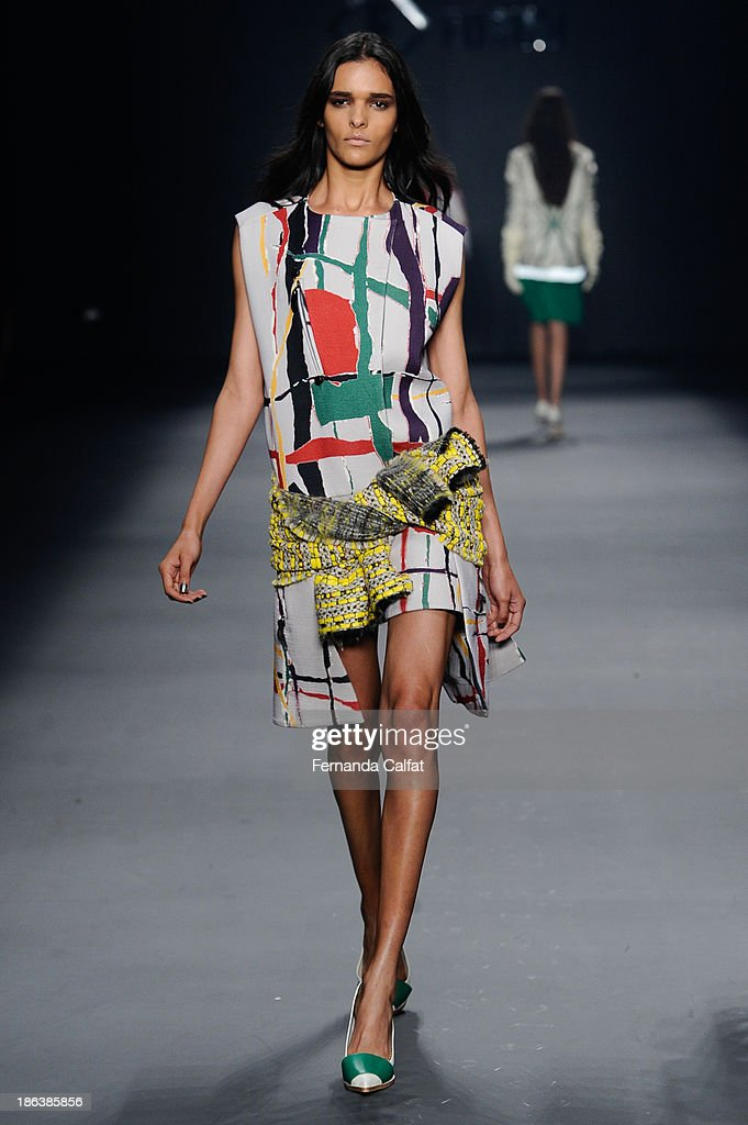 A model walks the runway during Forum show at Sao Paulo Fashion Week Winter 2014 on October 30, 2013 in Sao Paulo, Brazil.