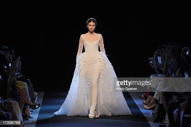 A model walks the runway during Georges Hobeika show as part of Paris Fashion Week HauteCouture Fall/Winter 20132014 at Palais De Tokyo on July 1...