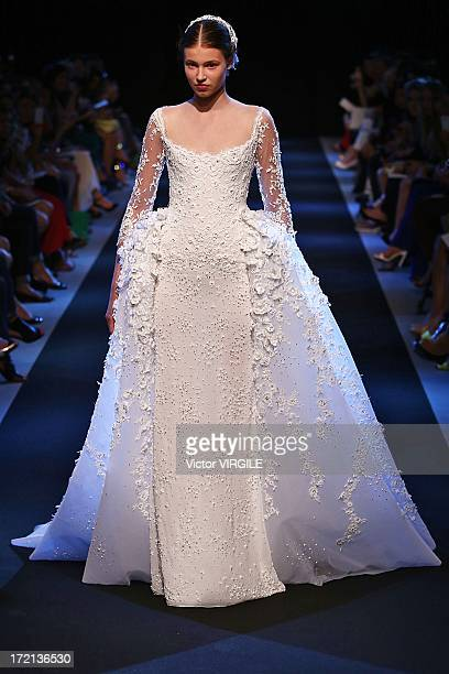 A model walks the runway during Georges Hobeika show as part of Paris Fashion Week HauteCouture Fall/Winter 20132014 on July 1 2013 in Paris France
