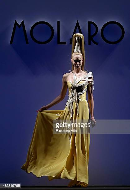 A model walks the runway during Gianni Molaro S/S 2014 Art Couture colletion fashion show as part of AltaRoma AltaModa Fashion Week at Santo Spirito...