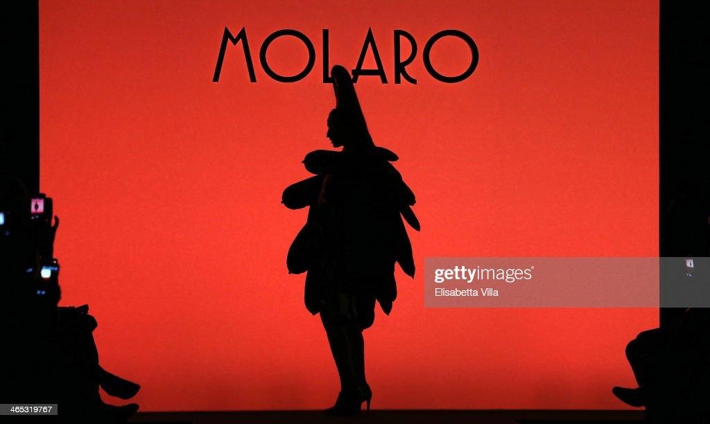 A model walks the runway during Gianni Molaro S/S 2014 Art Couture colletion fashion show as part of AltaRoma AltaModa Fashion Week at Santo Spirito...