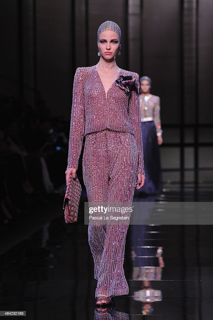 A model walks the runway during Giorgio Armani Prive show as part of Paris Fashion Week Haute Couture Spring/Summer 2014 on January 21, 2014 in Paris, France.