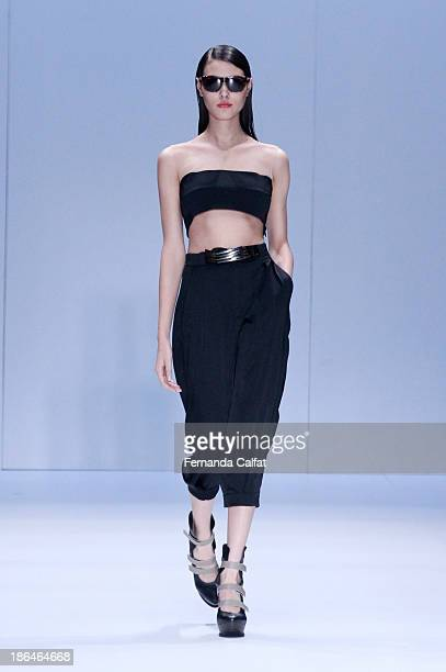 A model walks the runway during Gloria Coelho show at Sao Paulo Fashion Week Winter 2014 on October 31 2013 in Sao Paulo Brazil