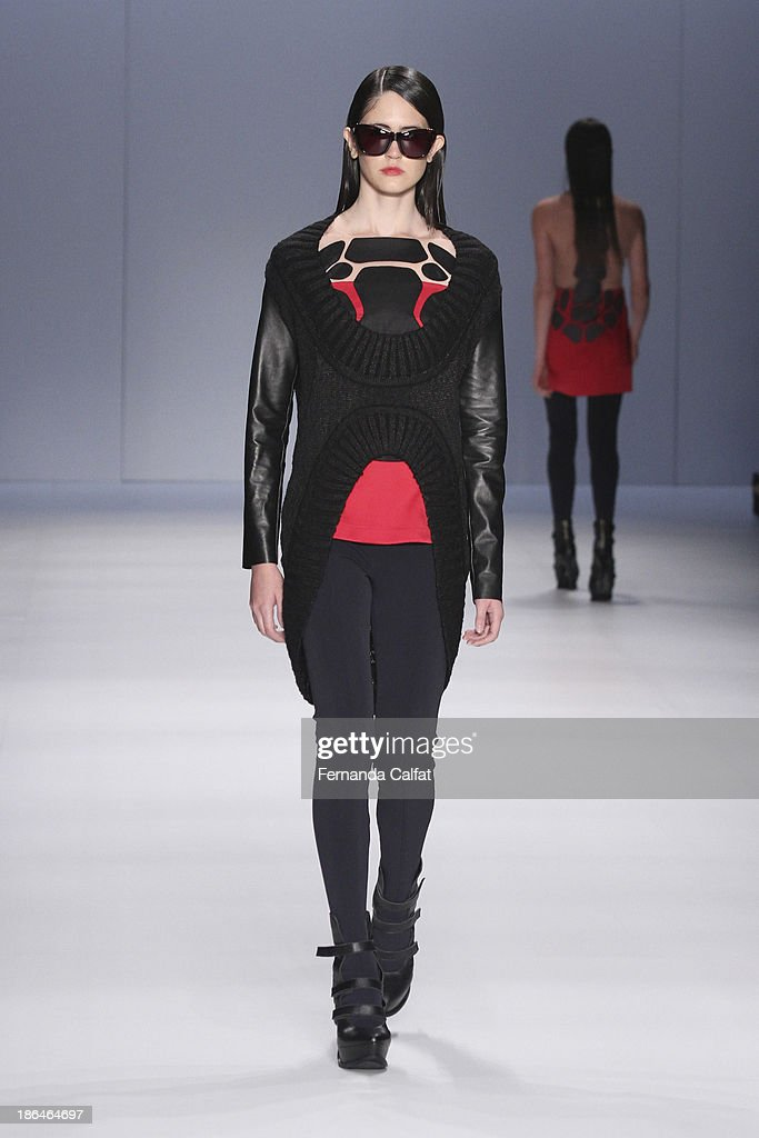 A model walks the runway during Gloria Coelho show at Sao Paulo Fashion Week Winter 2014 on October 31, 2013 in Sao Paulo, Brazil.