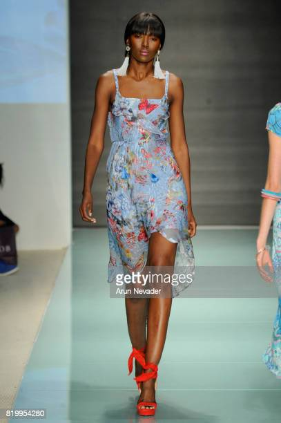 A model walks the runway during Hale Bob at Miami Swim Week Art Hearts Fashion at FUNKSHION Tent on July 20 2017 in Miami Florida