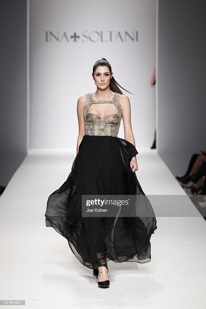 A model walks the runway during Ina Soltani fashion show during Style Fashion Week at L.A. Live Event Deck on March 9, 2014 in Los Angeles, California.