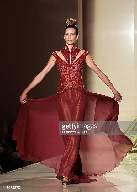 A model walks the runway during Jamal Taslaq fashion show as part of AltaRoma AltaModa A/W 2012 at Excelsior Hotel on July 9 2012 in Rome Italy