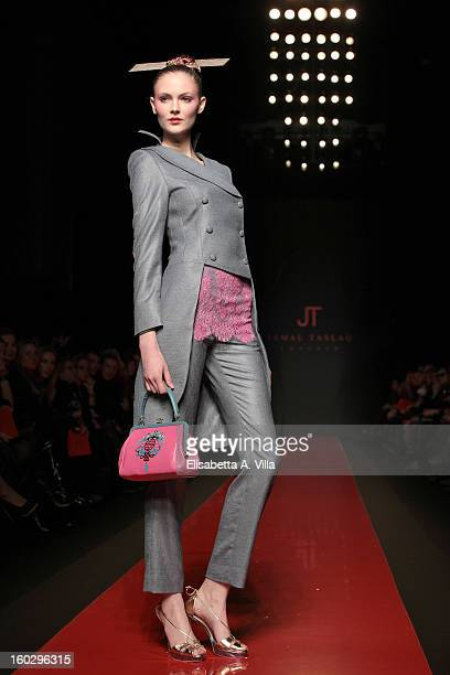 A model walks the runway during Jamal Taslaq S/S 2013 Haute Couture colletion fashion show as part of AltaRoma AltaModa Fashion Week at Santo Spirito...