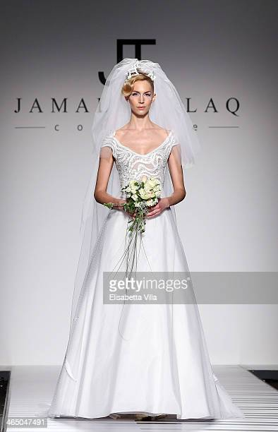 A model walks the runway during Jamal Taslaq S/S 2014 Haute Couture colletion fashion show as part of AltaRoma AltaModa Fashion Week at Santo Spirito...