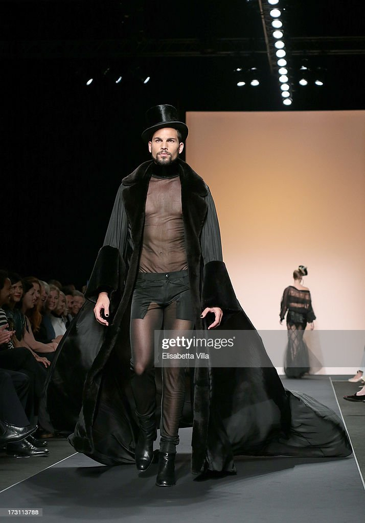 A model walks the runway during Jean Paul Gaultier Houte Couture Paris fashion show as part of AltaRoma AltaModa Fashion Week at Santo Spirito in Sassia on July 7, 2013 in Rome, Italy.