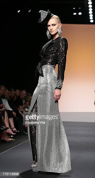 A model walks the runway during Jean Paul Gaultier Houte Couture Paris fashion show as part of AltaRoma AltaModa Fashion Week at Santo Spirito in...