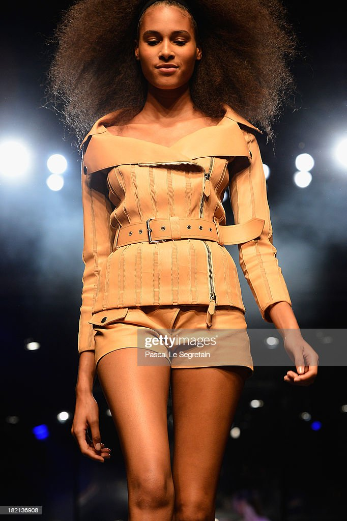 A model walks the runway during Jean Paul Gaultier show as part of the Paris Fashion Week Womenswear Spring/Summer 2014 at Le Paradis Latin on September 28, 2013 in Paris, France.