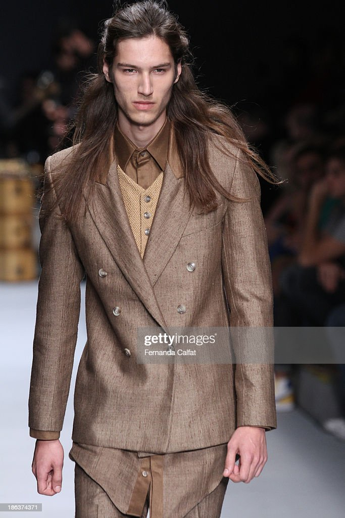 A model walks the runway during Joao Pimenta show at Sao Paulo Fashion Week Winter 2014 on October 30, 2013 in Sao Paulo, Brazil.