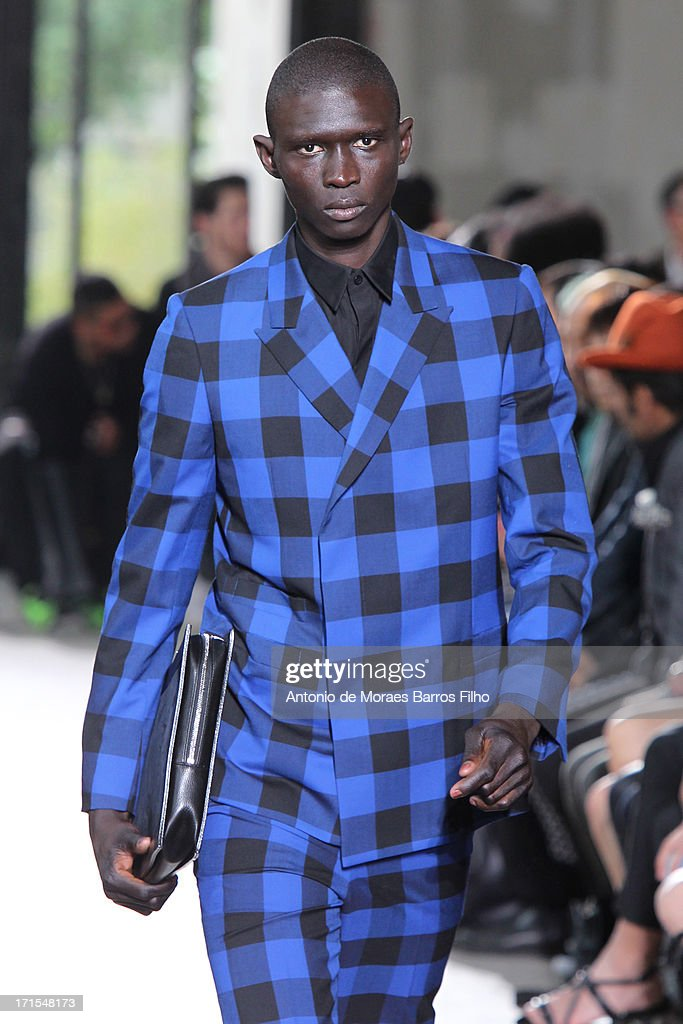 A model walks the runway during John Lawrence Sullivan Menswear Spring/Summer 2014 Show As Part Of The Paris Fashion Week on June 26, 2013 in Paris, France.