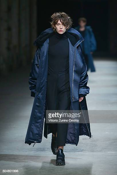 A model walks the runway during 'Juun J' Men's Fashion Show on January 13 2016 in Florence Italy
