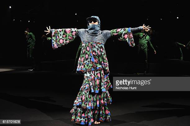 A model walks the runway during KENZO x HM Launch Event Directed By JeanPaul Goude' at Pier 36 on October 19 2016 in New York City
