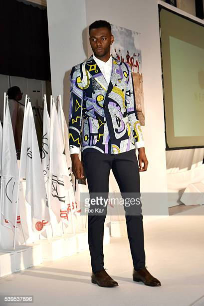 A model walks the runway during 'Labo International' 10th Edition African Ethnic and Sapeurs Fashion Show at Espace des Blancs Manteaux on June 11...