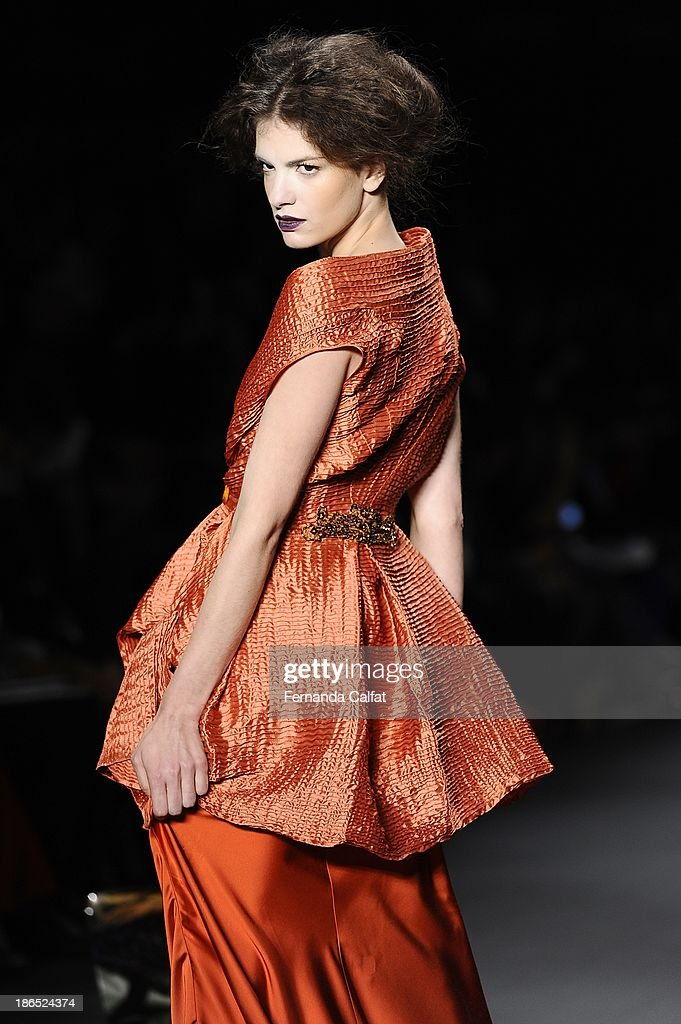 A model walks the runway during Lino Villaventura show at Sao Paulo Fashion Week Winter 2014 on October 31, 2013 in Sao Paulo, Brazil.