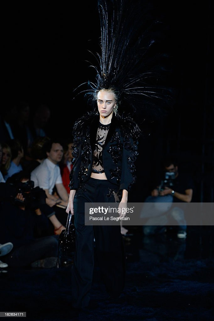 A model walks the runway during Louis Vuitton show as part of the Paris Fashion Week Womenswear Spring/Summer 2014 at Le Carre du Louvre on October 2, 2013 in Paris, France.