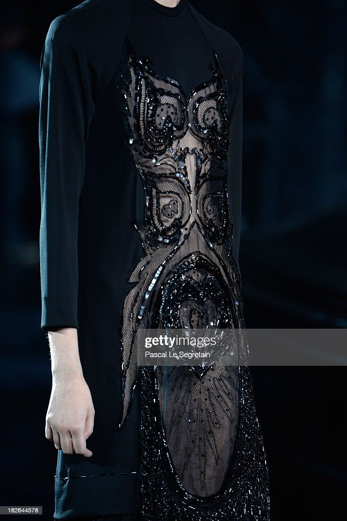 A model (dress detail) walks the runway during Louis Vuitton show as part of the Paris Fashion Week Womenswear Spring/Summer 2014 at Le Carre du Louvre on October 2, 2013 in Paris, France.