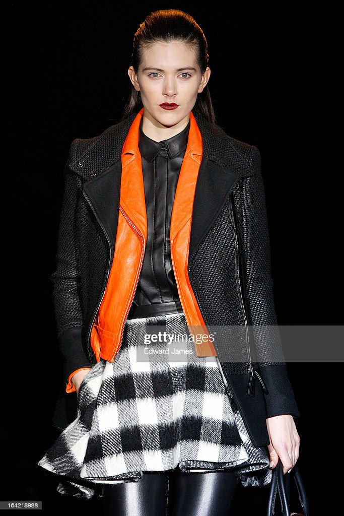 A model walks the runway during Mackage at David Pecaut Square on March 20, 2013 in Toronto, Canada.