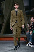A model walks the runway during Marni Fashion as a part of Pitti Immagine Uomo 87 on January 15 2015 in Florence Italy