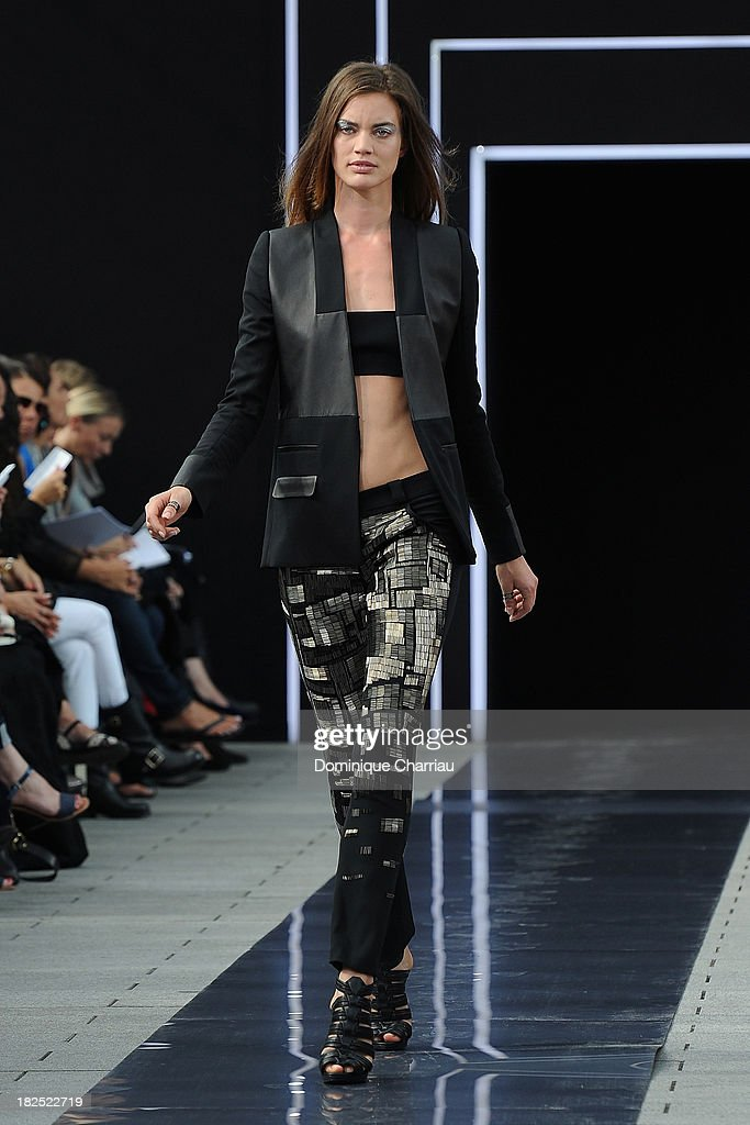 A model walks the runway during Maxime Simoens show as part of the Paris Fashion Week Womenswear Spring/Summer 2014 on September 29, 2013 in Paris, France.