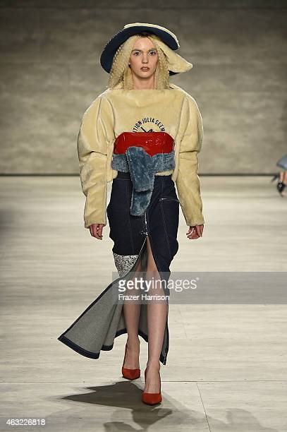 A model walks the runway during MercedesBenz Fashion Week Fall 2015 at The Pavilion at Lincoln Center on February 11 2015 in New York City