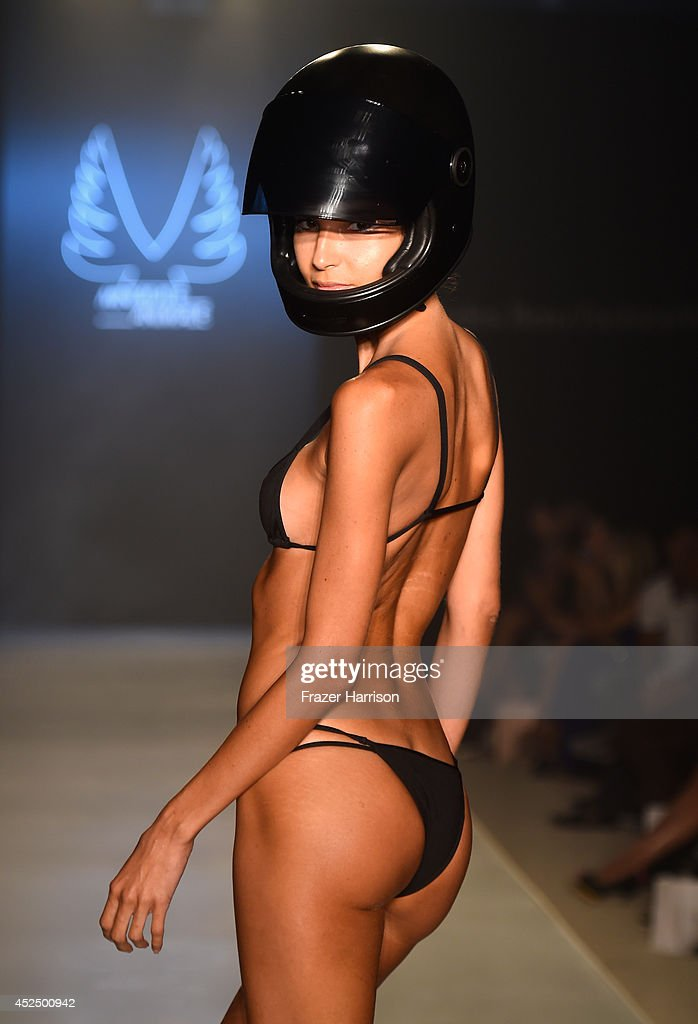 A model walks the runway during Minimale Animale show at Mercedes-Benz Fashion Week Swim 2015 at Raleigh Hotel on July 21, 2014 in Miami Beach, Florida.