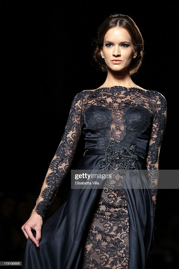 A model walks the runway during Mireille Dagher F/W 2013-2014 Haute Couture Colletion fashion show as part of AltaRoma AltaModa Fashion Week at Santo Spirito In Sassia on July 6, 2013 in Rome, Italy.