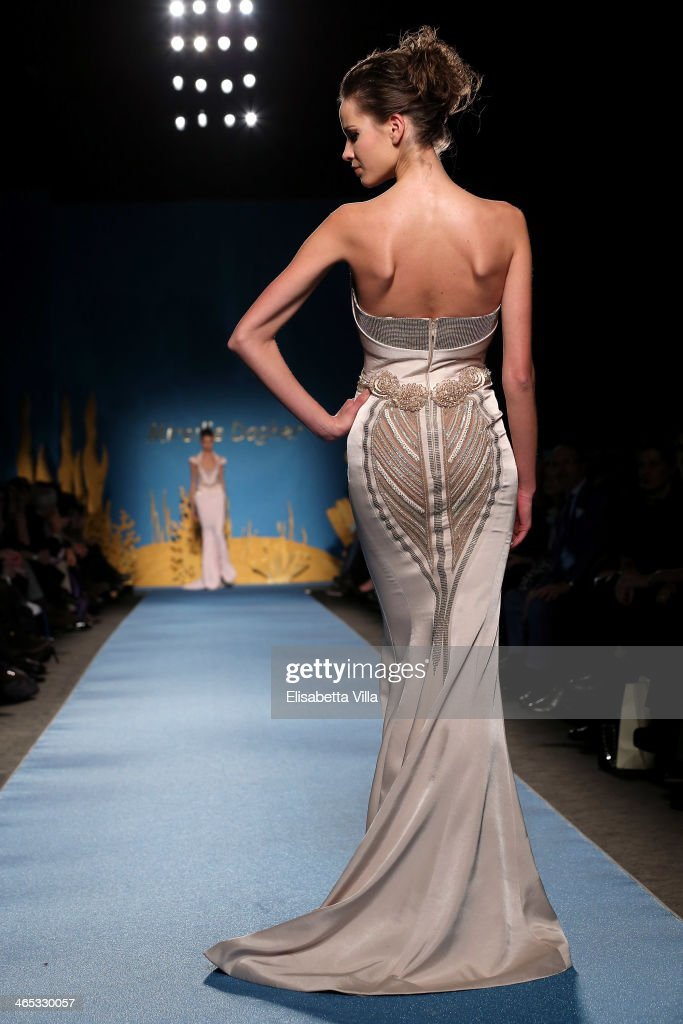 A model walks the runway during Mireille Dagher S/S 2014 International Haute Couture colletion fashion show as part of AltaRoma AltaModa Fashion Week...