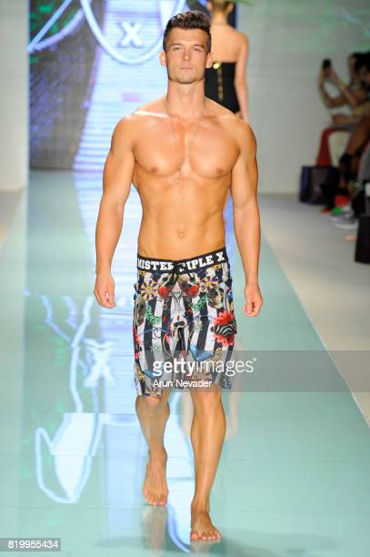 A model walks the runway during Mister Triple X at Miami Swim Week Art Hearts Fashion at FUNKSHION Tent on July 20 2017 in Miami Florida
