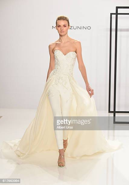 A model walks the runway during New York Fashion Week Bridal at the Mark Zunino For Kleinfeld at Kleinfeld on October 6 2016 in New York City
