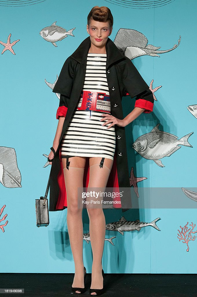 A model walks the runway during Olympia Le Tan show as part of the Paris Fashion Week Womenswear Spring/Summer 2014 at the Paris aquarium on September 26, 2013 in Paris, France.