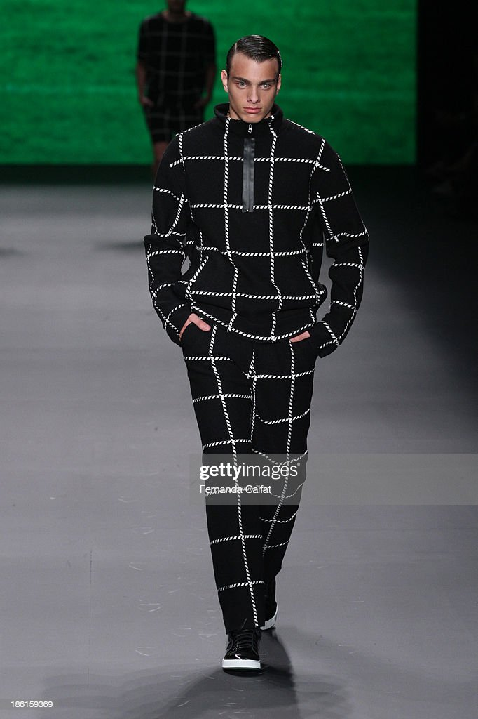A model walks the runway during Osklen show at Sao Paulo Fashion Week Winter 2014 on October 28, 2013 in Sao Paulo, Brazil.