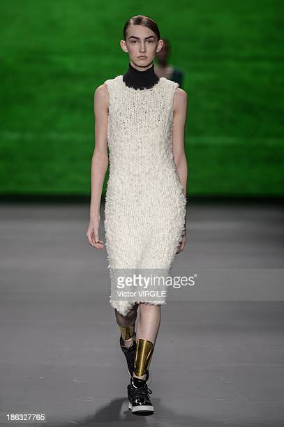 A model walks the runway during Osklen show at the Sao Paulo Fashion Week Winter 2014 on October 28 2013 in Sao Paulo Brazil