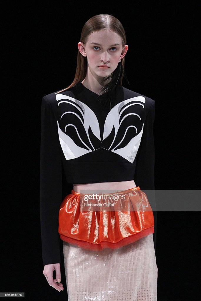 A model walks the runway during Pedro Lourenco show at Sao Paulo Fashion Week Winter 2014 on October 31, 2013 in Sao Paulo, Brazil.