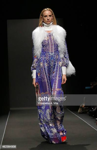 A model walks the runway during PiccionePiccione F/W 2015 colletion fashion show as part of AltaRoma AltaModa Fashion Week at Maxxi Museum on January...