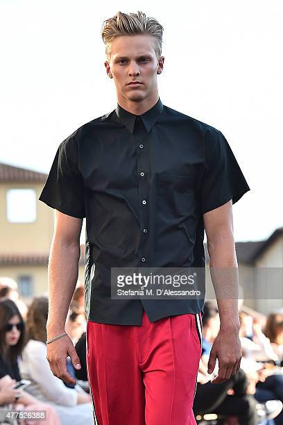 A model walks the runway during 'Ports 1961' Men's Fashion Show Spring/Summer 2016 as part of 88 Pitti Uomo on June 17 2015 in Florence Italy