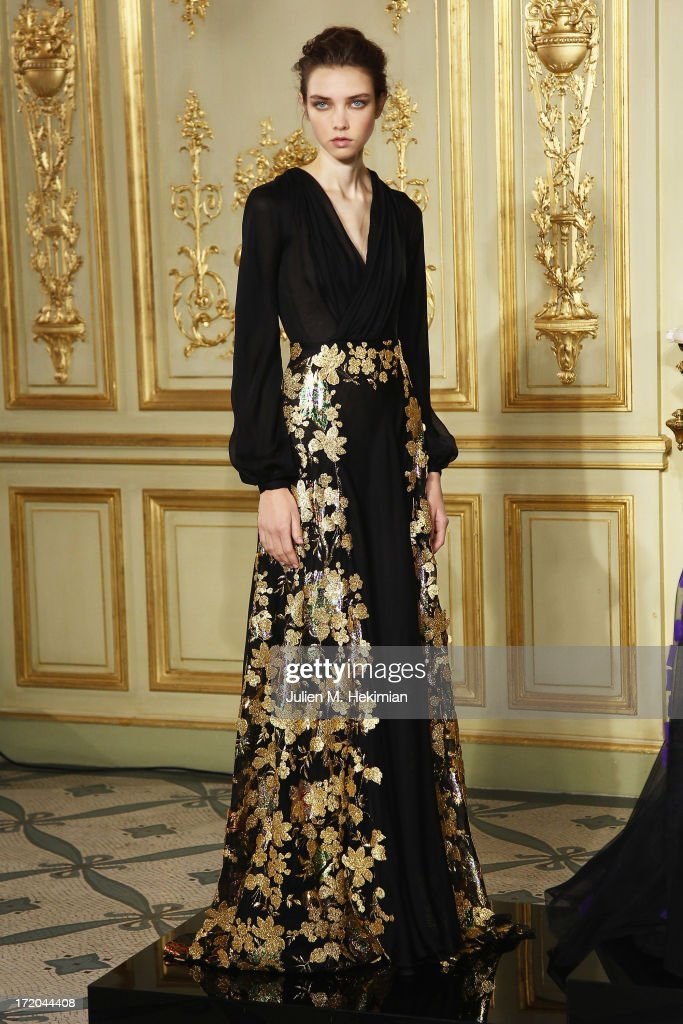 A model walks the runway during Rami Al Ali show as part of Paris Fashion Week Haute-Couture Fall/Winter 2013-2014 at on July 1, 2013 in Paris, France.