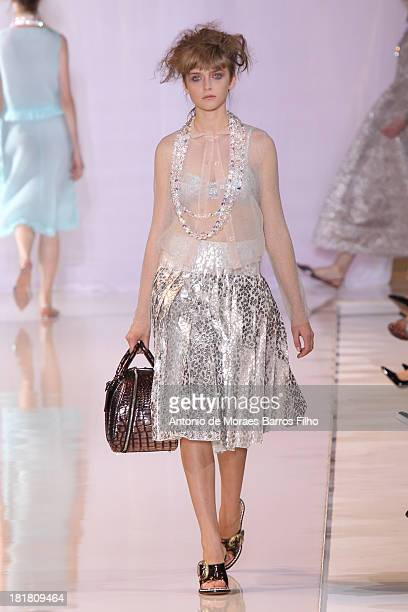 A model walks the runway during Rochas show as part of the Paris Fashion Week Womenswear Spring/Summer 2014 on September 25 2013 in Paris France