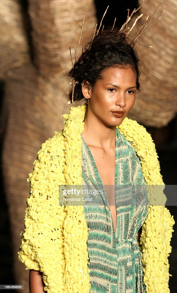 A model walks the runway during Ronaldo Fraga show at Sao Paulo Fashion Week Winter 2014 on October 31, 2013 in Sao Paulo, Brazil.