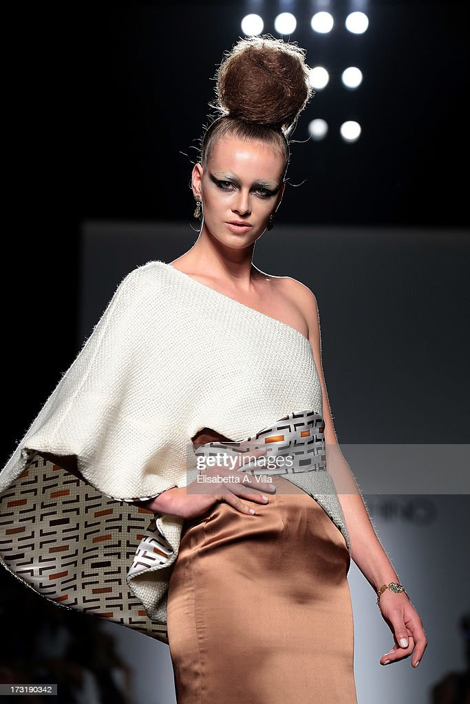 A model walks the runway during Sabrina Persechino F/W 2013-2014 Haute Couture collection fashion show as part of AltaRoma AltaModa Fashion Week at Santo Spirito In Sassia on July 9, 2013 in Rome, Italy.